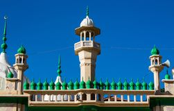 Mosque green domes and minaret towers. Muslim religion traditional architecture buildingwith minara Royalty Free Stock Image