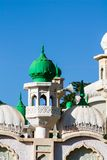 Mosque green domes and minaret towers. Muslim religion traditional architecture buildingwith minara Royalty Free Stock Photo