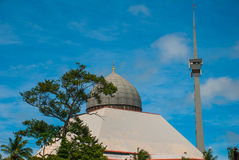 Mosque grey against the blue summer sky. Sandakan, Borneo, Sabah, Malaysia. Mosque grey against the blue summer sky. Sandakan city, Borneo, Sabah, Malaysia royalty free stock photography