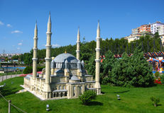 Mosque with high minarets in the park Miniaturk in Istanbul, Turkey. Scale model of a Mosque or mosk with high minarets and several domes on the roof in the stock photos