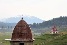 Mosque and Hindu temple in mountains of Kashmir Royalty Free Stock Photography