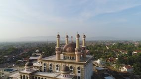 Mosque in indonesia. Beautiful mosque with minarets on island Java Indonesia. aerial view mosque in an asian city stock footage