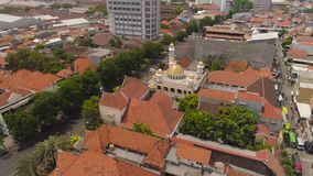 Mosque in indonesia. Beautiful mosque with minarets in surabaya on island Java Indonesia. aerial view mosque in an asian city stock video