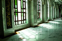 Mosque interior. Mosque ceramic hallway with colorful stained windows Stock Image