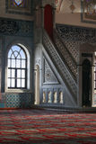 Mosque interrior. Colorful mosque interrior with window, stained glass snd red carpet Stock Photography