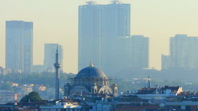 Mosque in Istanbul with skyscrapers in the background stock footage