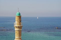 Mosque in Jaffa, Tel Aviv. Minaret of Al-Bahr Mosque in Jaffa, Tel Aviv and the Mediterranean Sea in the background stock image