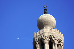Mosque with jet contrail in egypt Royalty Free Stock Photos