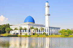 A mosque in Malaysia. Reflection of mosque over the water Stock Photography