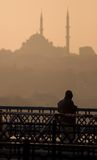 Mosque and Man. Silhouette of man with Mosque in Istanbul Royalty Free Stock Images