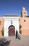 A Mosque in Marrakech, Morocco. The name Marrakech originates from the Amazigh (Berber) words mur (n) akush, which means go and stop which was said a long years Stock Images