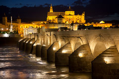 Mosque (Mezquita) and  Roman Bridge at beautiful night, Spain, Royalty Free Stock Photography