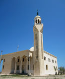 Mosque with minaret. White mosque with minaret on sunlight and blue background Stock Photos