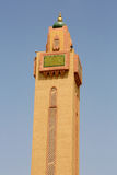 Mosque minaret against a blue sky Stock Photography