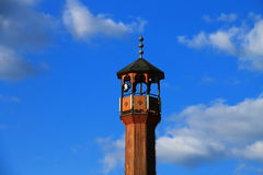 Mosque minaret with beautiful blue sky and clouds. In Bosnia and Herzegovina Stock Images