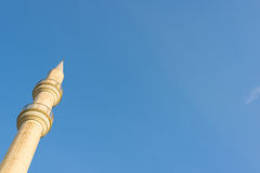 Mosque minaret on a blue sky background Royalty Free Stock Photo