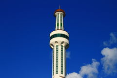 Mosque minaret with blue sky and clouds. Mosque minaret with beautiful blue sky and clouds Royalty Free Stock Images
