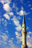 Mosque minaret on cloudscape vertical Stock Photography