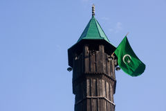 Mosque minaret with flag stock photography