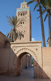 Mosque and minaret in Marrakesh, Morocco. Marrakech, Morocco: entrance to muslim mosque Royalty Free Stock Photography