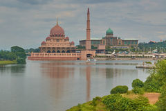 red mosque with a minaret and the residence of the Sultan against the background of the lake Royalty Free Stock Images