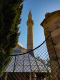 Mosque minaret. A view of a mosque with minaret against the blue sky stock photography