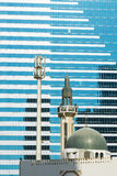 Mosque and modern building Abu Dhabi Stock Photo