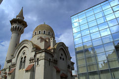 Mosque and modern building Stock Images