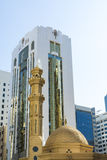 Mosque and modern buildings Abu Dhabi Stock Photography