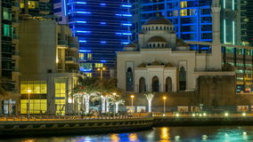Mosque among modern high rise buildings, towers and hotels timelapse at Dubai Marina, United Arab Emirates, Middle East stock video footage
