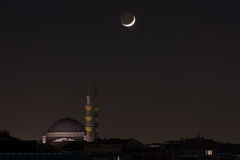 Mosque with moon Stock Images