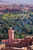 Mosque in Morocco with village and palmtree forest.  vector illustration