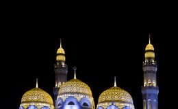 Mosque in Muscat. With illuminated minarat Stock Photo