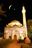 Mosque in night with crescent and star above. Mosque in the Stock Photos