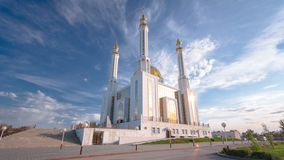 Mosque Nur Gasyr in the city of Aktobe timelapse hyperlapse. Kazakhstan. Mosque Nur Gasyr in the city of Aktobe timelapse hyperlapse. Blue cloudy sky before stock video