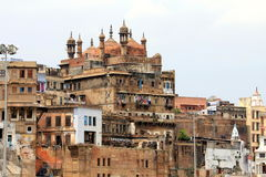 The mosque overlooking Varanasi. Varanasi cityscape with houses and mosque Royalty Free Stock Photo