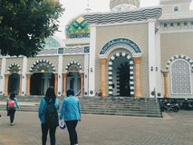 Mosque at Pacitan Indonesia. Students walked in front of a beautiful mosque at Pacitan Indonesia stock photography