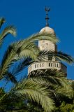 Mosque between the palm tree branches Stock Images