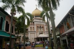 Mosque, palm trees and Arab Street Singapore. A view of the main dome of Singapore`s historic Sultan Masjid. Sultan Masjid is the second largest Islamic mosque Royalty Free Stock Image