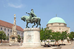 Mosque Qazim and Obelisk in Pecs Hungary. Obelisk and Statue of a Horseback Rider in front of Mosque Qazim in the Main Square in Pecs Hungary Stock Image