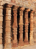Mosque, Qutb Minar, Delhi. Ruins of the mosque at Qutb Minar - built from the stones of destroyed Hindu temples, their animal and human figures defaced Stock Images