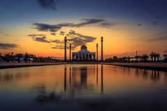 Mosque reflection in water. Mosque reflection in a mirror-like water stock photo