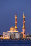 Mosque in Sharjah at dusk. Mosque in Sharjah illuminated at dusk, United Arab Emirates Stock Image