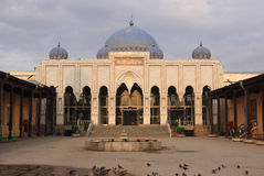 The mosque of Sheikh Massal ad-Din in Khujand city, Tajikistan. The mosque was built in 1512-1513. Multi-column (30 columns) avian adjacent to the eastern wall Stock Photography