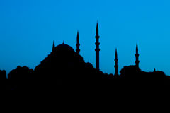 Mosque silhouette on blue background Royalty Free Stock Photography