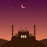 Mosque silhouette in the evening with stars and crescent Royalty Free Stock Photo