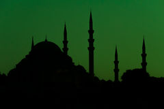 Mosque silhouette on green background Stock Image