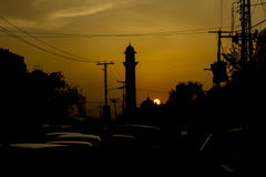 Mosque silhouette in Lahore, Pakistan. With a traffic jam Stock Images