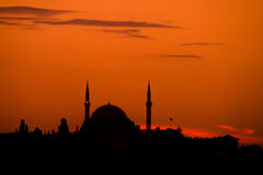 Mosque silhouette orange sky background Stock Photos