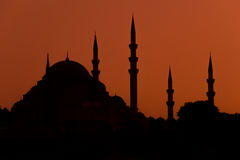 Mosque silhouette on red background Stock Photo